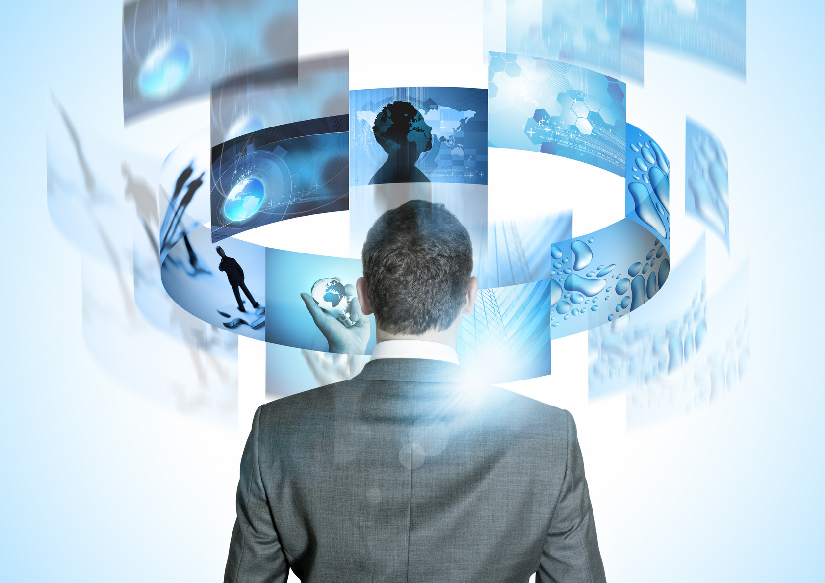 Modern Business World, A businessman looking at rotating business images.